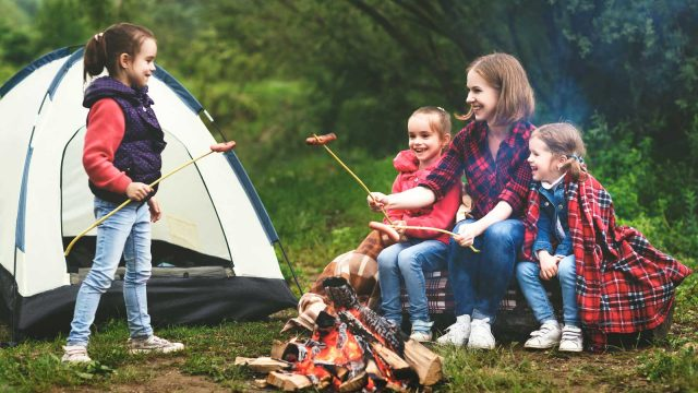Family camping at campsite